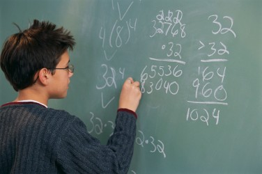 Performing Math Calculations at Chalkboard
