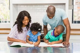 Parents helping children doing homework